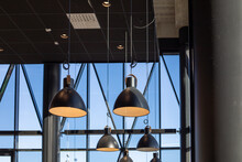 Modern Lamps Hanging From A Ce...