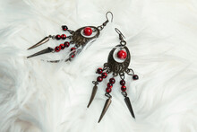 Two Ethnic-style Earrings On A Soft Fluffy Fabric