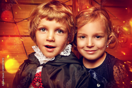 Fototapeta boy and girl in costumes
