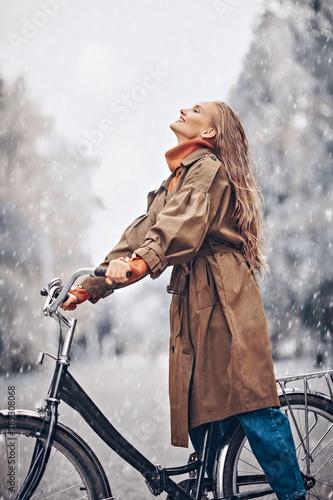 Fototapeta joyful girl by bike obraz