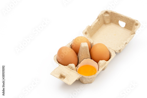 open egg box brown on yellow Fotobehang