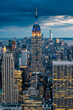 Close up view of the Empire State Building and New York City skyline on a beautiful evening with city lights