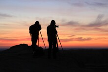 Silhouette Of Photographers On...
