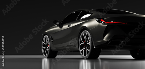 Rear view of modern black premium car in studio light