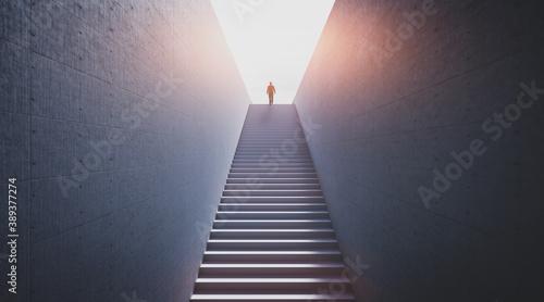 Man going upstairs towards light