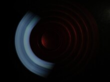 A Close View Of Spinner Game In Dark