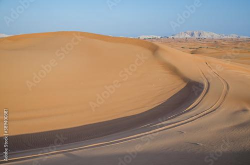 Landscape of desert sand dunes under the sunlight - perfect for wallpapers Fototapet