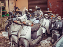 Several Mopeds Stand In A Litt...