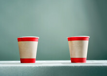Two Cardboard Coffee Cups With...