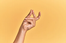 Arm And Hand Of Caucasian Man Over Yellow Isolated Background Snapping Fingers For Success, Easy And Click Symbol Gesture With Hand