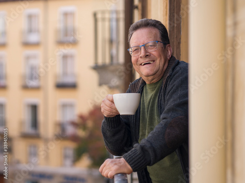 Fotografie, Obraz lifestyle portrait of happy and cheerful mature man 65 to 70 years old at home b