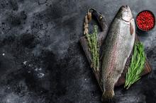 Raw Rainbow Trout Fish On A Cu...