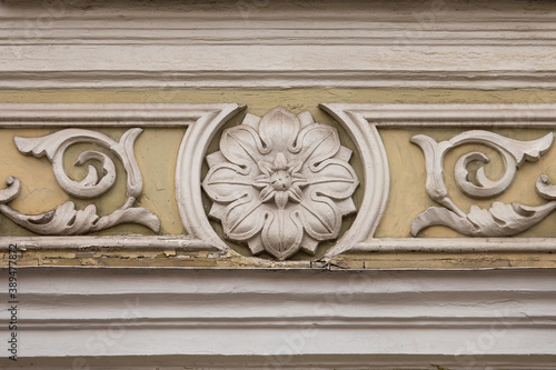 Fototapeta Floral stucco moulding rosette on the wall