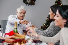 Latin Old Man Eating On A Chri...