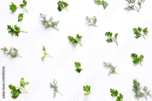 Carta da parati Fresh parsley and dill on white background