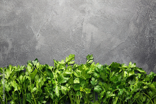 Fototapeta Fresh parsley on grey background obraz