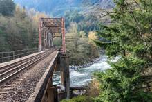 Train Tressel Crossing River In Wilderness