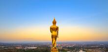 Golden Buddha Standing On A Mountain Nan Province, Thailand.