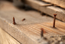 Rusty Nails In Old Wooden Board