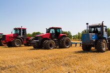 Agricultural Tractor Plowing A...