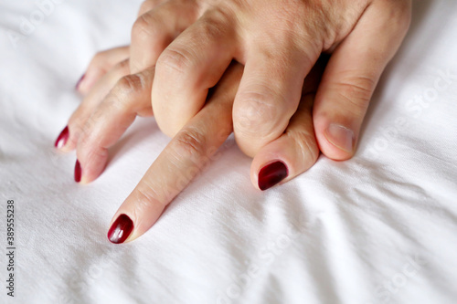 Male and female hands on a bed, couple having sex Fotobehang