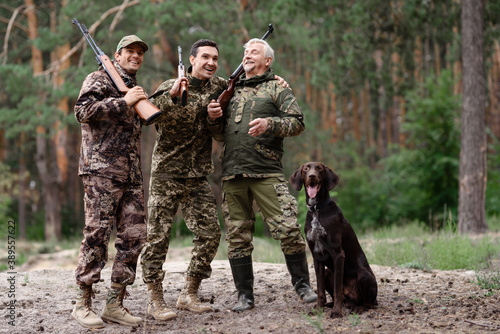 Carefree Hunters in Forest Weekend Together. Fototapet