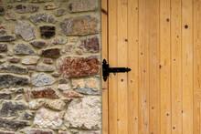 Black Hinge Of New Wooden Plank Gate