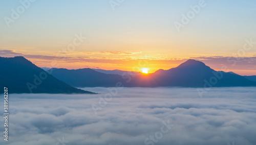 Fototapeta beautiful sunrise over mountain with fog in the morning obraz