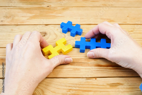 Fototapeta Closeup hand connecting jigsaw puzzle, business solutions, success and solving problem concept obraz