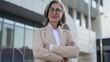 Self confident senior woman in elegant business suit posing at camera, success