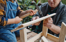 Unrecognizable Small Boy With Senior Grandfather Constructing Birdhouse, Diy Project.