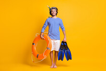 Full Size Photo Of Guy Hold Life Buoy Flippers Wear Snorkeling Mask Goggles Striped Shirt Shorts Isolated Om Yellow Color Background
