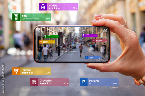 Concept of augmented reality technology being used in mobile phone for navigation and location based services