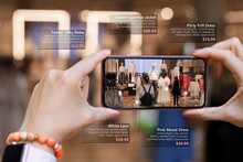 Augmented Reality Tech Used By Woman On Her Phone While Shopping For New Clothes In Store