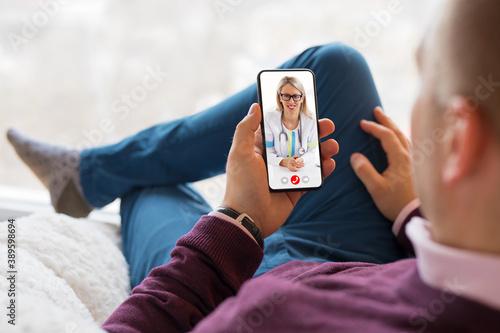 Fotografija Man talking with doctor on video call