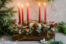 Decorative Christmas Composition With Five Red Candles And Pine