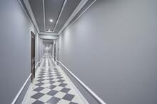 Empty Long Gray Corridor In Ho...