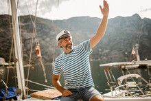 Mature Man Standing At Helm Of...