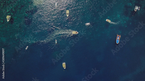 Obraz na plátně Drone photo of motorboats on the Mediterranean sea on the coast of Taormina in S