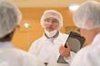 Leinwandbild Motiv Medical team standing in hospital, getting feedback