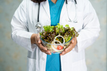 Nutritionist Doctor Holding Sa...