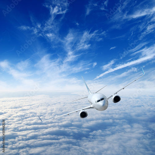 Airplane in the sky. Passenger Airliner in clouds.