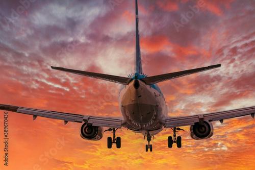 big plane landing during sunset