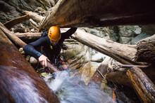 Man Exploring Canyon Climbs Th...