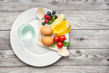 Interval Fasting Diet Concept Represented With A Plate And Products