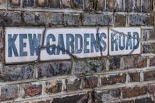 Kew Gardens Road Sign On A Brick Wall.