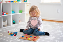 Little Child Playing With Puzzles. Toddler Activities