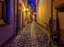 Narrow Medieval Street At Night, Old District In European Town