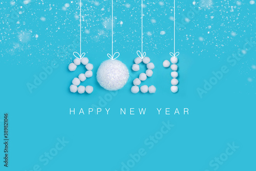 Papel de parede 2021 New Years numbers made of white artificial snow and balls on a blue backgro