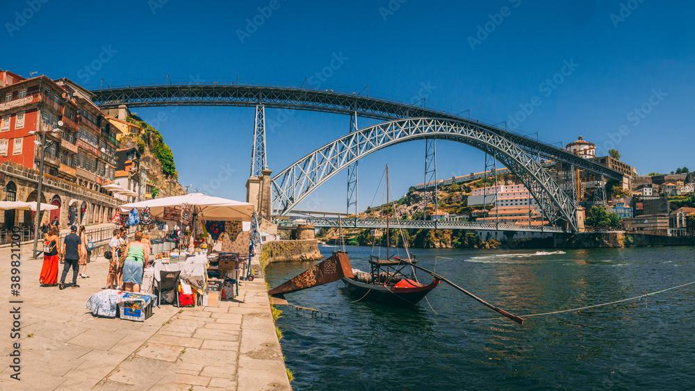 Fototapeta PORTO, PORTUGAL - Jul 18, 2020: Colorful boat tours along Douro river are a popular attraction for domestic
